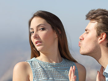 woman avoiding being kissed