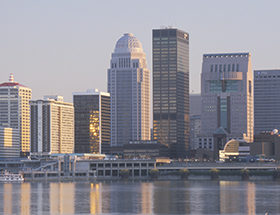 Louisville skyline reflected in the river