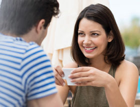 Woman smiling at a man as a sign she likes him
