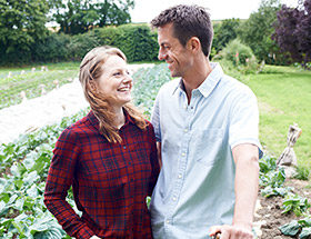 happy couple in field outside