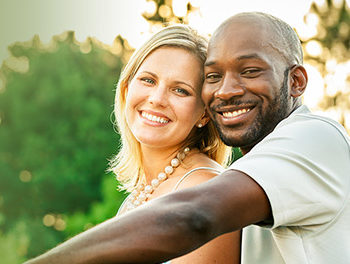 black and white couple smiling together