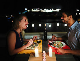 couple sitting in rooftop restaurant