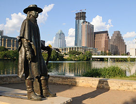 Statue of Stevie Ray Vaughn looking out across Austin