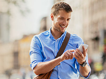 Man using his smartphone to try out a dating app