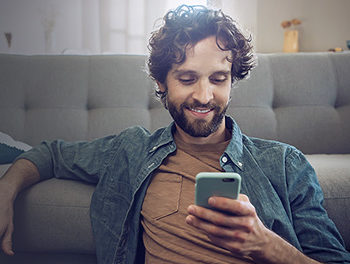 single man happy after asking someone out over text