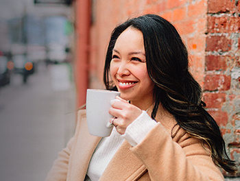 woman-enjoying-coffee-thinking-of-the-best-places-to-meet-single-women